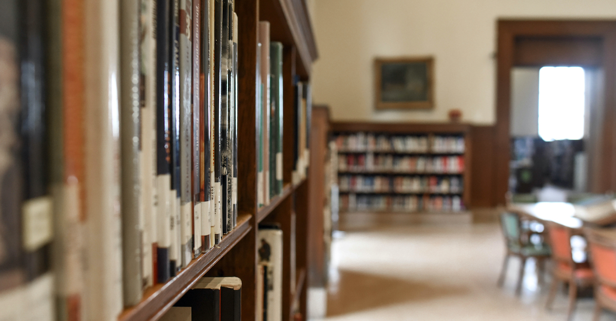 College library in soft focus with books in foreground